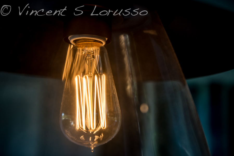 The warm glow of an Edison style light bulb.